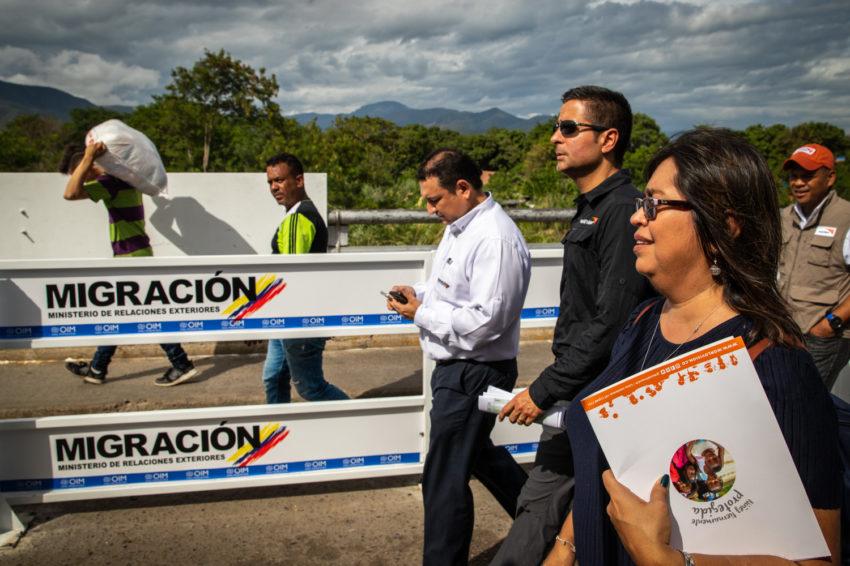 People walk in Colombia.