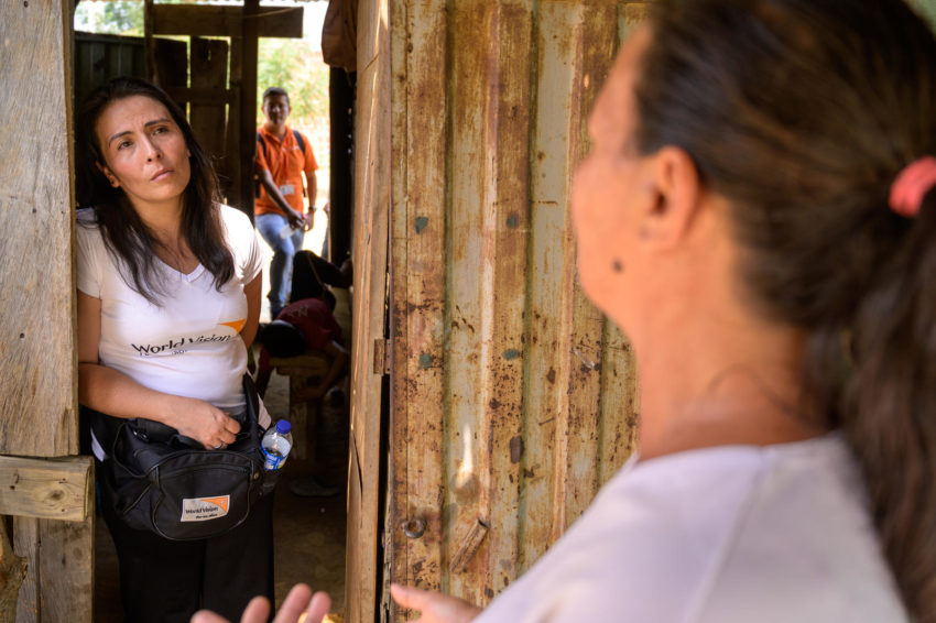 Mayerly Sanchez visits a Venezuelan migrant family that receive food vouchers from World Vision. A former sponsored child, Mayerly is now communications manager for World Vision in Colombia. Years of economic and political instability in Venezuela have led to about 4 million people leaving the country. in recent years, the United Nations migration organization says.