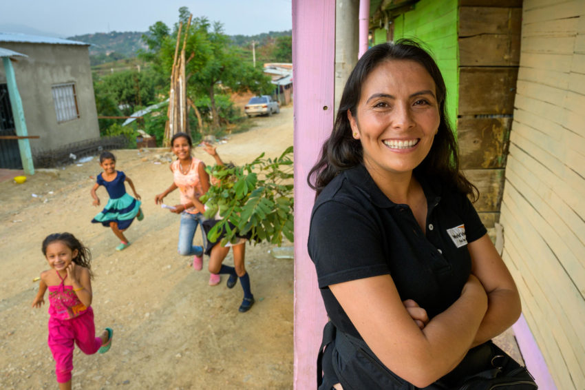 Mayerly Sanchez, World Vision communications manager for Colombia visits Caracole community near the Venezuela border in Cucuta. As a sponsored child she was active in a youth peace movement that was nominated for the Nobel Peace Prize. Colombia has long been affected by violence and conflict.