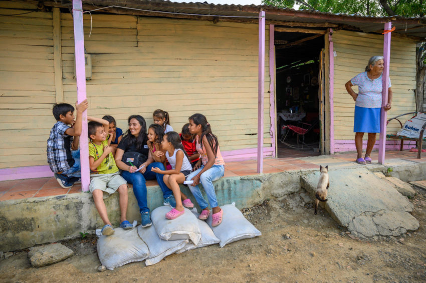 """Colombia is struggling to recover from entrenched poverty and societal violence as well as coping with high volumes of Venezuelan migrants. Communications manager Mayerly Sanchez talks to children in a low-income community where World Vision works. """"I grew up in a neighborhood like this, a place where people are just getting by and there are few hopes and aspirations,"""" says Mayerly. A former sponsored child, Mayerly was a leader in a youth peace movement that was nominated for the Nobel Peace Prize when she was a teenager."""