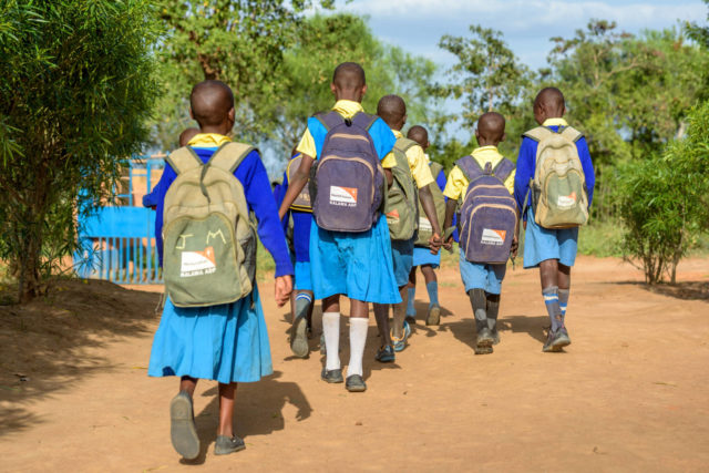 School children head home after class, wearing their World Vision backpacks in Kalawa Area Program in Kenya.