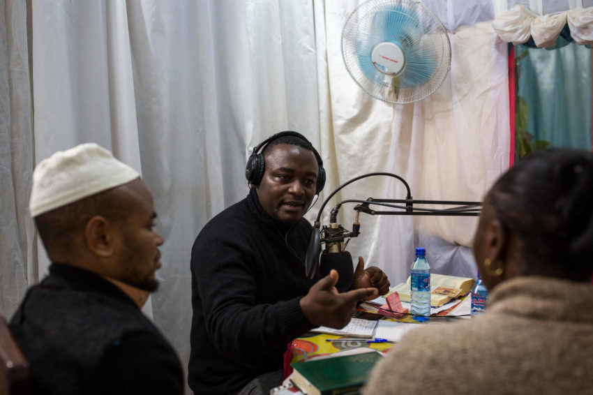 The second largest Ebola outbreak in history is in DRC. After Channels of Hope training by World Vision, Priest Claude Mbakani, 33, and an imam talk about Ebola prevention and address listeners' questions during a twice-weekly radio show supported by World Vision in Butembo.