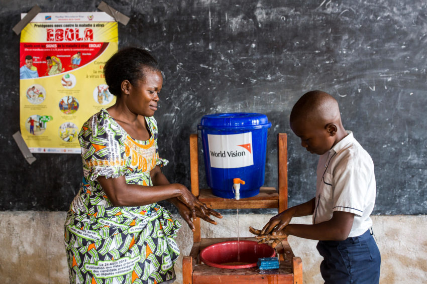 Ebola outbreak in the northeast of the Democratic Republic of Congo. Teacher Françoise Mbambu teaches students about Ebola and how to wash their hands to prevent it. World Vision trained her and gave handwashing kits to her school in Beni, DRC. (©2019 World Vision/photo by Patrick Meinhardt)