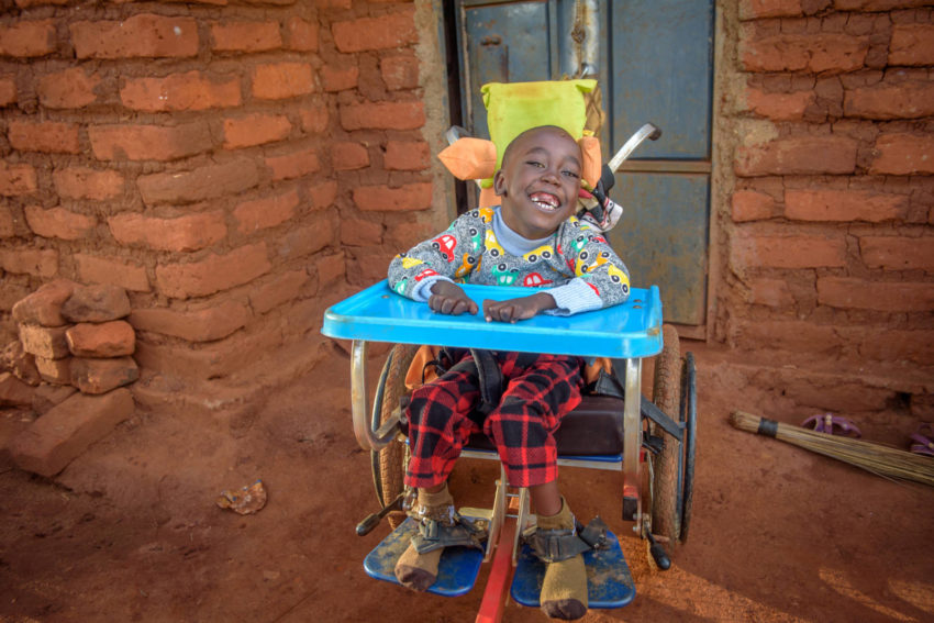 Dennis Ngumbau is all smiles in his new wheelchair.