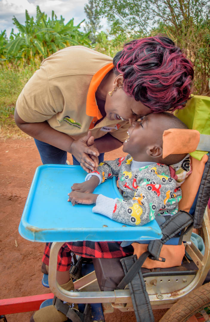 Eight-year-old Dennis lights up when World Vision Child Well-being Facilitator Annastacia Mutunga visits his home.