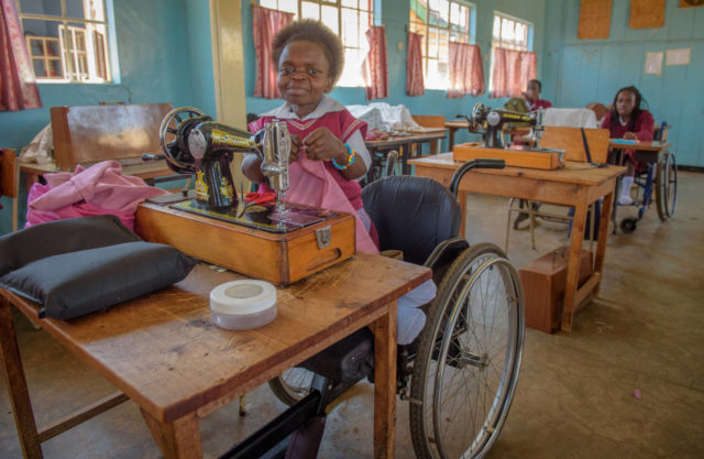 Judith learns sewing as a part of her education at Nyabondo Rehabilitation Center. She hopes to get her own sewing machine once she finishes her studies.