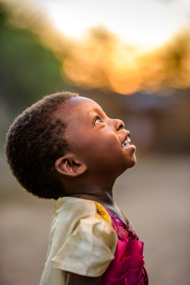 In Zambia, seventeen-month-old Beauty's joy is infectious, her face beaming with wonder.