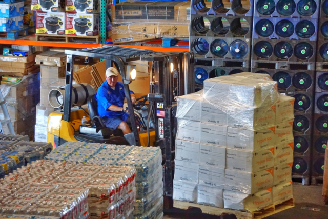 As Hurricane Dorian approaches the Florida Atlantic coast, Frank Rincon, director of the Benison Center unloads World Vision relief supplies for staging at a warehouse in Immokalee.