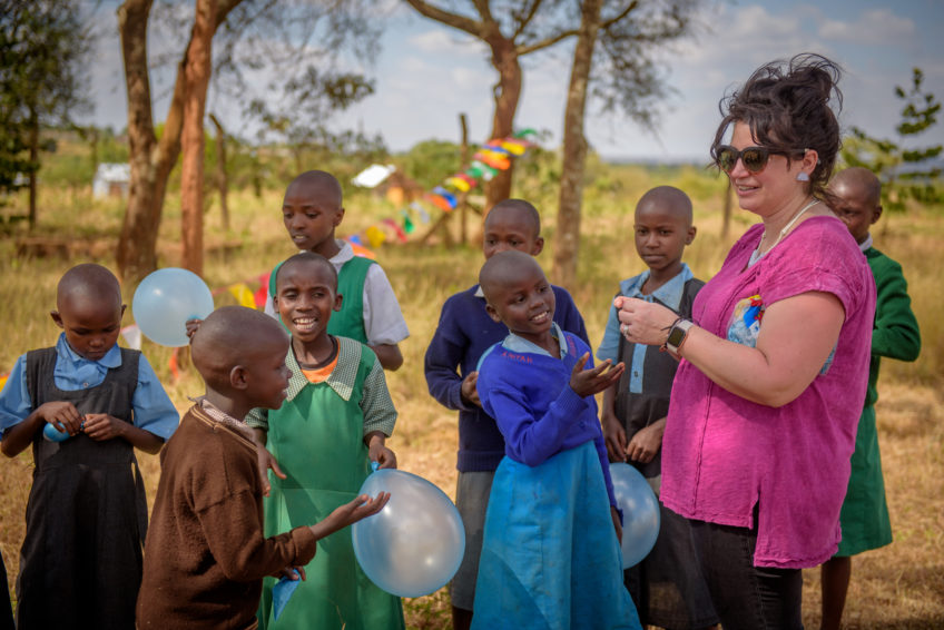 Children hold balloons at a child sponsorship event in Kenya