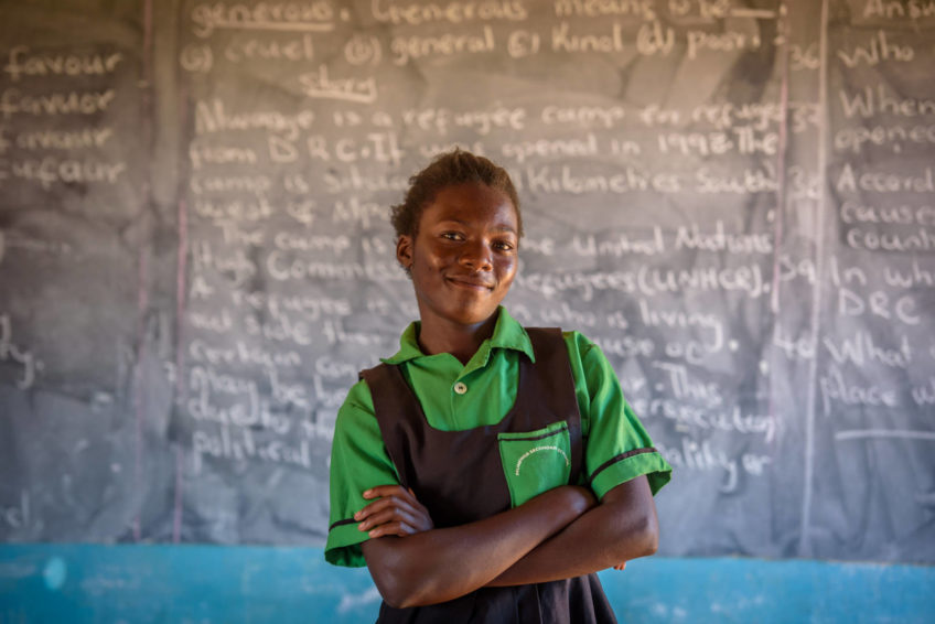 Felistus Malyoongo, 15, was lured into child marriage at age 14, but the local child protection committee brought her back home. Now 15, she stands in a classroom of the school she attends in rural Zambia.
