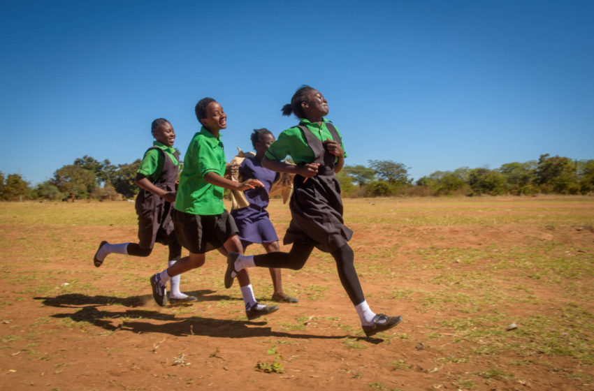 Felistus Malyoongo, 15, leads the pack of girls practicing for a track meet at her school in Zambia. A former child bride, she has returned to school where she excels at her studies and is a dedicated athlete who loves to compete.