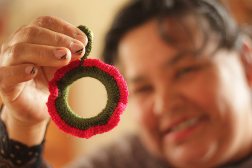 Some mothers in Bolivia crochet Christmas ornaments to earn extra money.