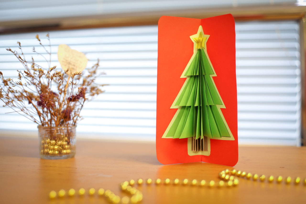 Christmas card with Christmas tree made from construction paper.