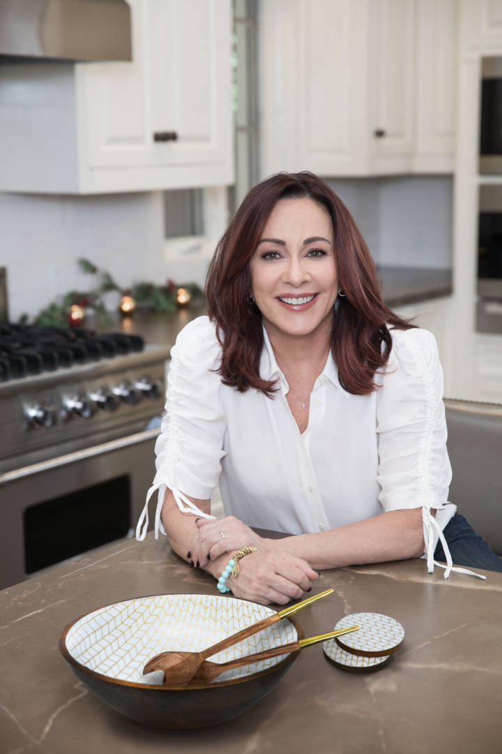 Emmy® winner Patricia Heaton poses next to a hand-carved artisan bowl exclusively for World Vision.
