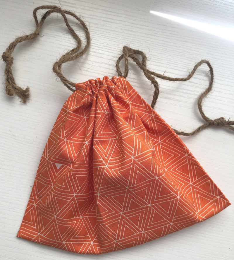 In this sewing tutorial, blogger Melanie Ham shows how to sew a simple drawstring bag that can be sent as a gift for the sponsored child who chooses you.