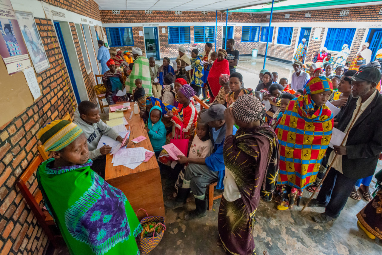 Women and children wait for treatment at Kigogo Heath Clinic in Rwanda. The clinic's maternity ward was funded by World Vision, which also furnished the clinic's water system.