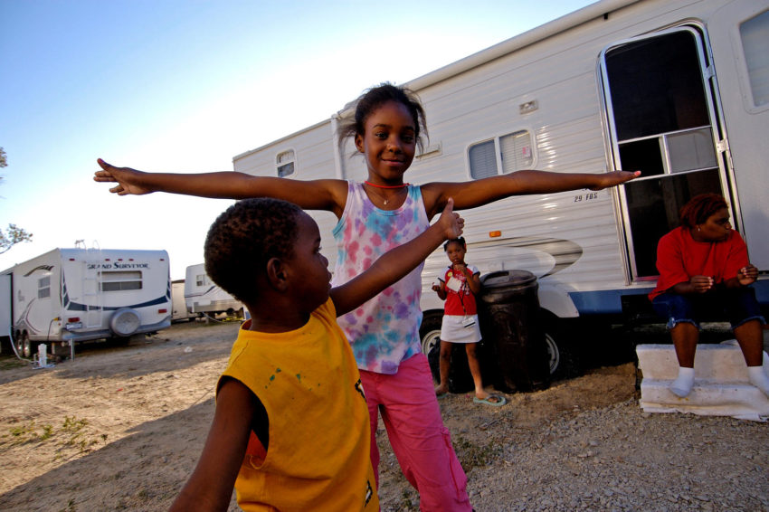 Hurricane Katrina uprooted families for months or years. Deshon Hardy and her children, Allen Hardy, 4, Dazjha McGee, 10, and DiYana McGee, 7, fled their home in New Orleans when Hurricane Katrina struck. Here, the children play outside their FEMA trailer in Baton Rouge while Deshon sits on trailer steps.