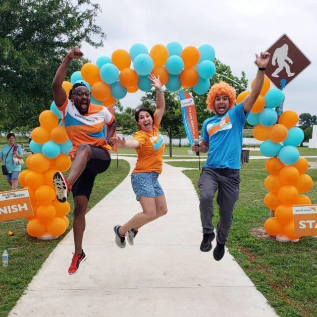 Participants at a Global 6K for Water site in Austin, Texas, jump for joy at the 2019 event. Leap into the new year with that kind of excitement, and this could be you.