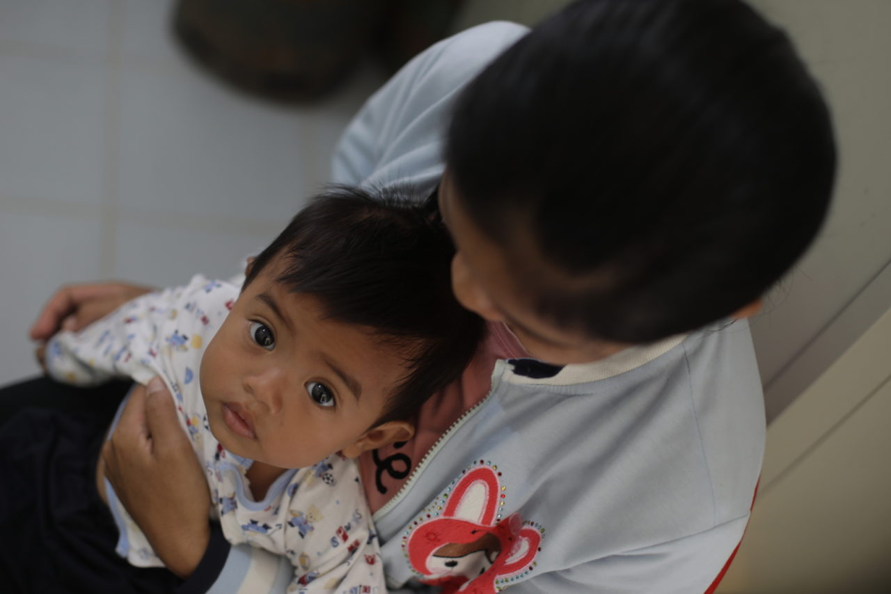 A Cambodian mother brings her baby to a health center for vaccinations and well-baby check-ups.