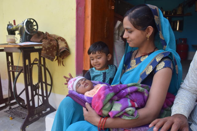At their home in India, Monika, 22, and her 3-year-old son, Ayush, gaze at Monika's youngest child, 1-month-old Rishika, peacefully sleeping. When she was carrying Rishika, Monika lost weight because of nausea and vomiting. She turned to another mother, Neha, a World Vision-trained volunteer, for support. Neha provided iron and calcium supplements and advised her to eat the simple, easily digested food she needed to deliver a healthy baby.