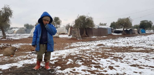 A camp for internally displaced people in northwest Syria offers a bleak and cold existence for Samer*, 5. Aid workers are working around the clock to provide emergency support, but with tens of thousands of people arriving every day, supplies are low and the humanitarian response is overwhelmed. *Name changed to protect identity.