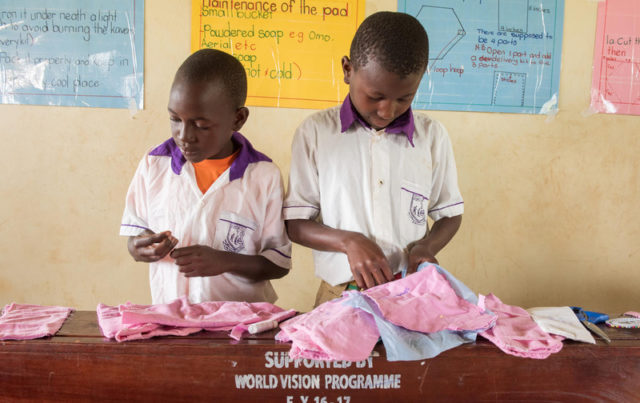 Boys sew fabric as part of a WASH club learning to make menstrual pads. Globally, girls in developing countries often miss school while on their periods. By missing class for up to a week each month, it often leads to them dropping out altogether. World Vision works with Sesame Workshop to help change that by teaching both boys and girls how to make hygienic reusable menstrual pads so girls can still attend class while on their periods.