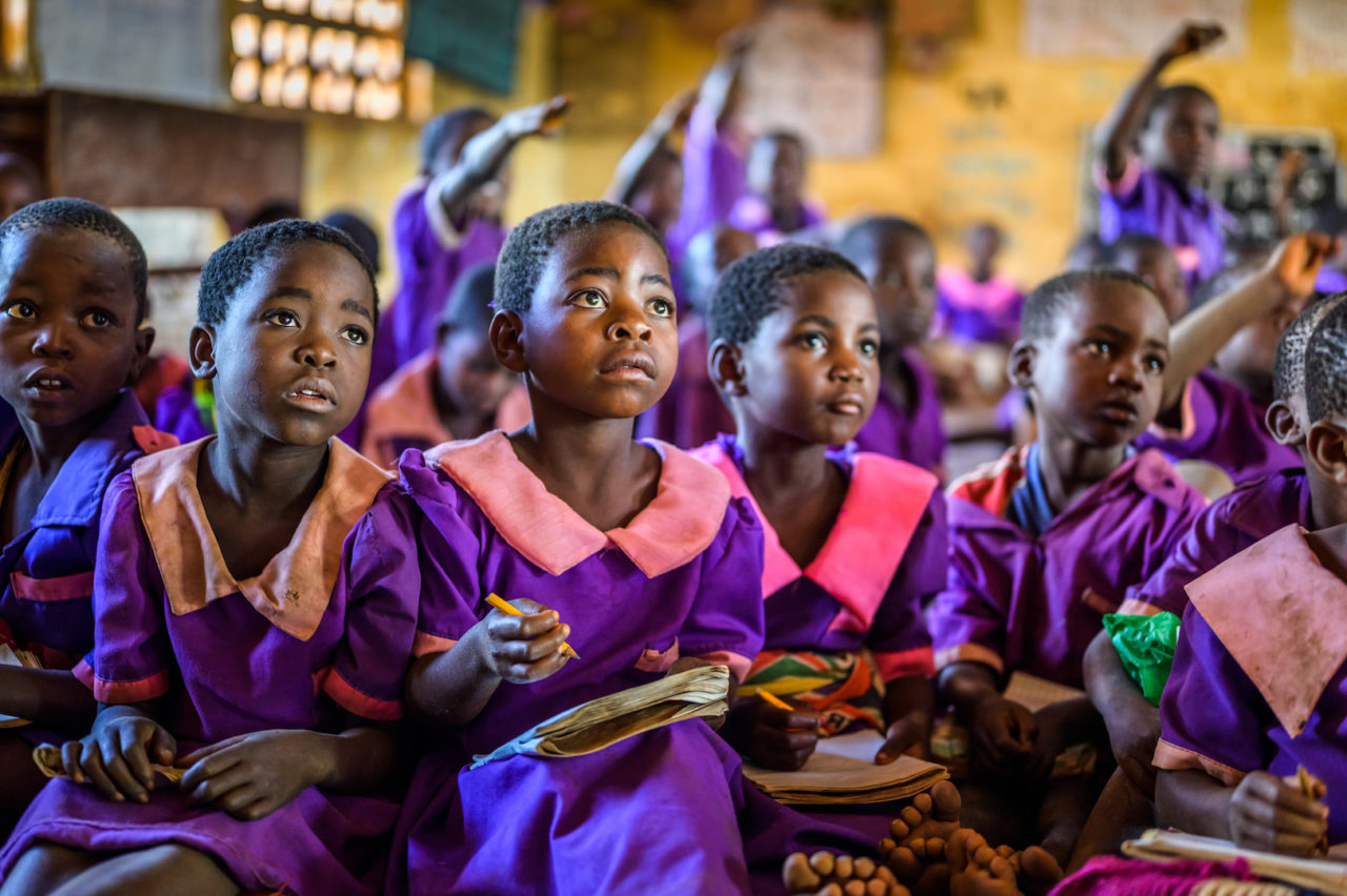 Ireen (center) is a serious student and topEIght-year-old Ireen sits in class with her peers.
