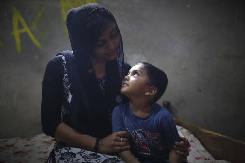 Masrafi gazes up at his mother at his home in Bangladesh. He had the opportunity to choose his sponsor last year and chose World Vision U.S. President Edgar Sandoval Sr. and his wife, Leiza.
