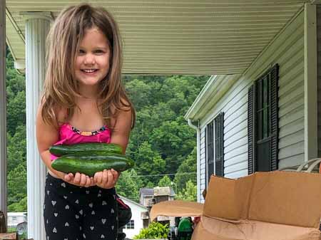 Four-year-old Phoenix in West Virginia was giddy with delight when she saw cucumbers in the Fresh Food Box she received from World Vision through its partnership with Mountain Heart Community Services.