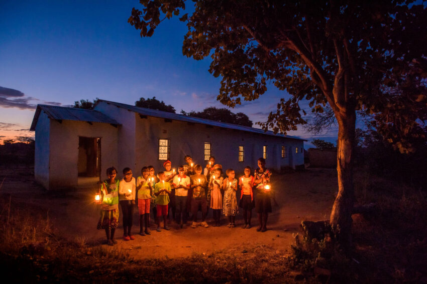 Children hold candles and sing in Moyo, Zambia. Join author Danielle Strickland as she pauses to pray during this especially chaotic Christmas season. Take postures of surrender, generosity, and mission, taking time to build toward a peaceful life in the Advent season.