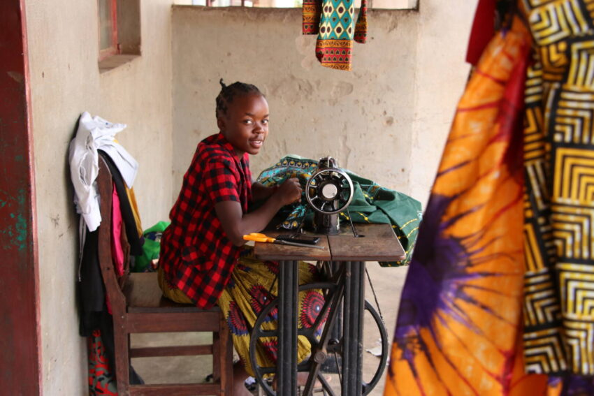 Mwila earns money sewing and selling clothes. These funds will go toward her education.