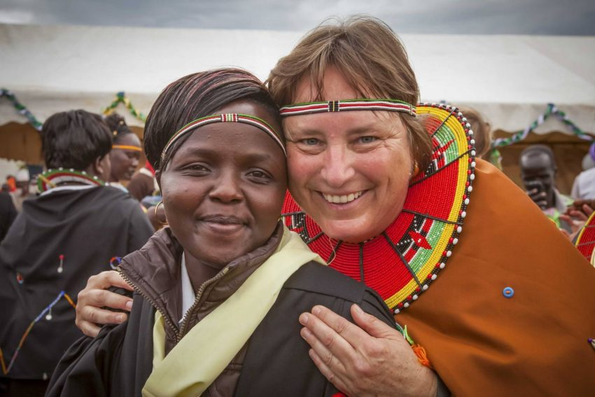 Margo Day smiles with a friend named Lillian during Margo's 2014 trip to Kenya to celebrate an expansion of the school she funded. She initially met Lillian during a 2009 visit at the rescue center.
