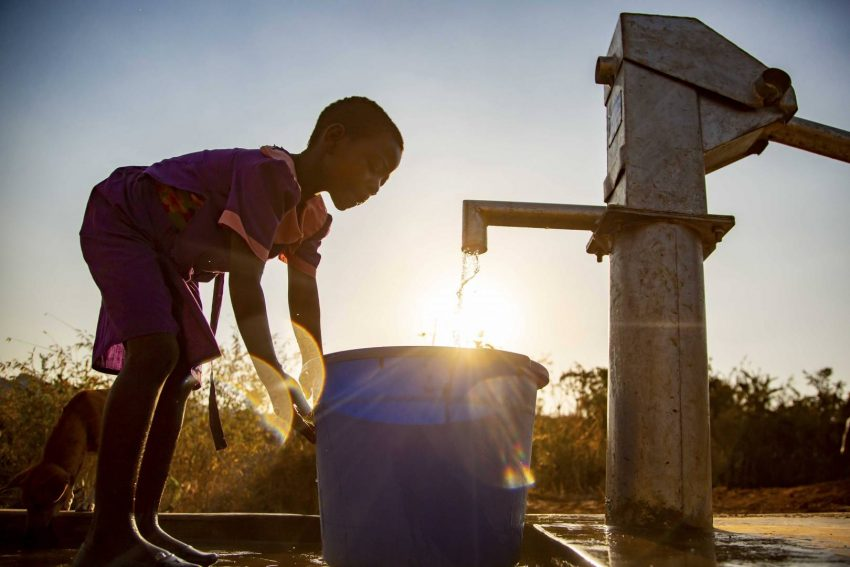 Ireen gets water at the new borehole well installed in her community. Having clean water will be a game changer for her future.