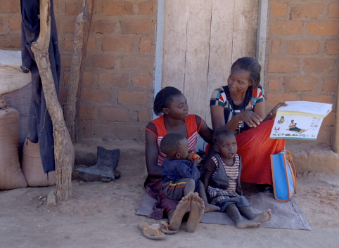 Doreen and her children listen as Rhoda, a community health worker, educates them about better health practices in Zambia.