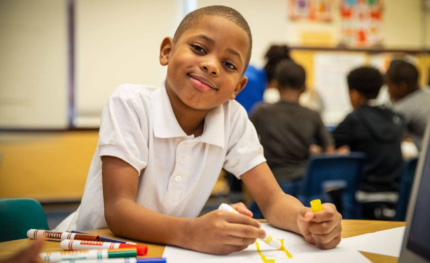 A student uses school supplies from World Vision in an art class at a Chicago elementary school.