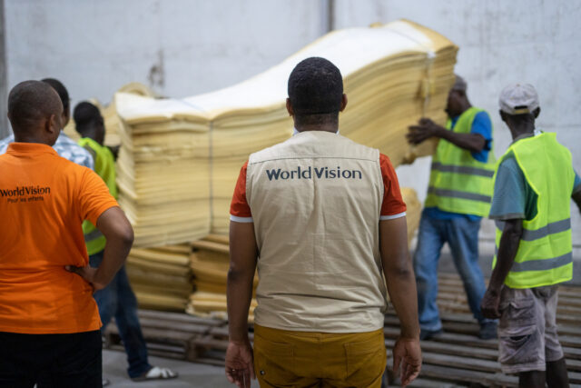 Relief workers in Haiti load supplies for distribution