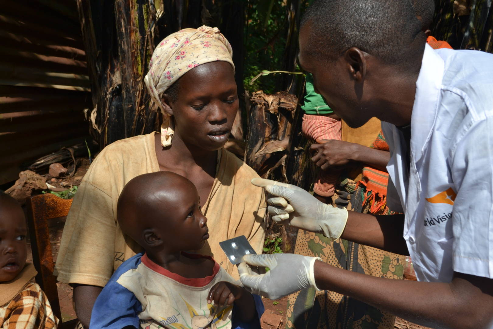 At his home in northeast Burundi, community health worker Diomede, right, diagnoses and treats common ailments of children under age 5. Malaria is among the three most deadly diseases for children this young. (©2016 World Vision, Javan Niyakire)