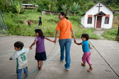 In a Christian community in Bolivia, World Vision staff lead children to to a small chapel for activities. ©2011 World Vision, Jon Warren