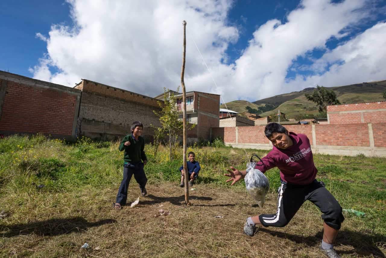 "Children in Colomi, Bolivia play tetherball. The ""ball"" is made of a plastic bag densely packed with lots of other plastic bags. Despite being a country rich with resources, Bolivia is one of the poorest countries in Latin America. Donors from the United States sponsor more than 19,200 girls and boys in Bolivia. ©2015 Eugene Lee/World Vision"
