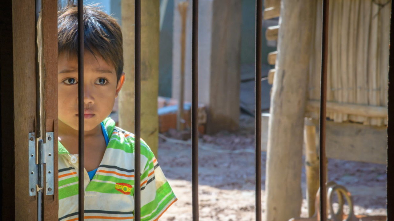 A young boy looks in at the Children's and Youth Club in Cambodia. © 2015 World Vision, Laura Reinhardt