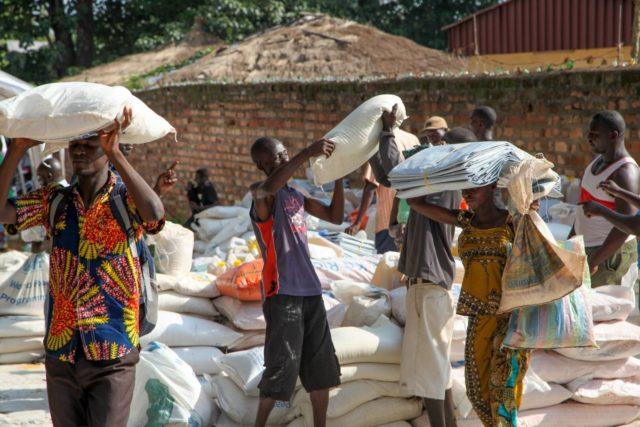 About 200 families came to receive rice and oil provisions that were only enough for 80 families in Bangui, Central African Republic. This is a common happening in the country where food insecurity is on the rise and humanitarian funding is insufficient to meet the need. (©2015 World Vision, Bruno Col) Humanitarian news