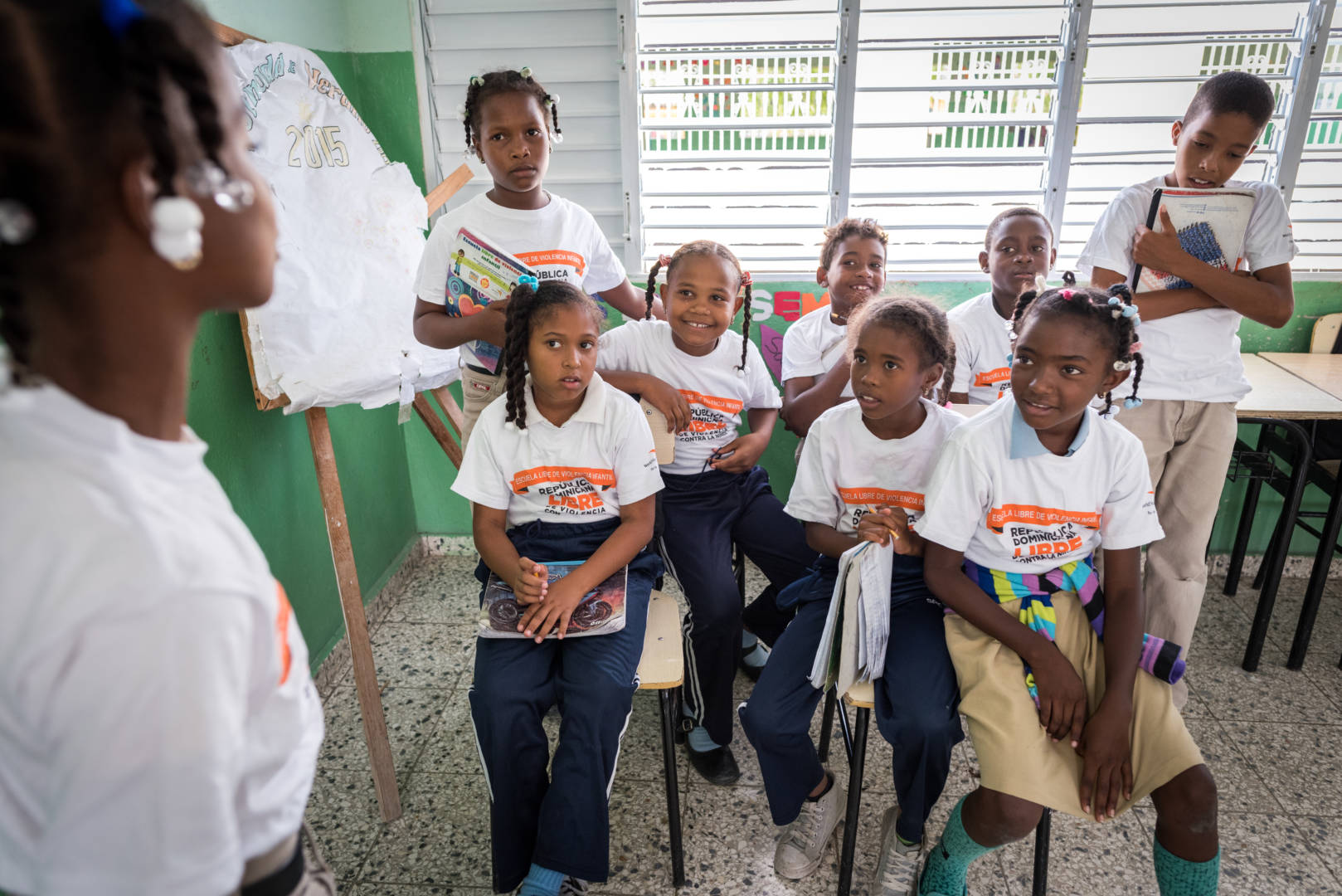 Students at Centro Educativo Las 100 elementary school in the Dominican Republic participate in an anti-bullying workshop skit. Skits show kids how to talk through problems, express themselves, and identify when to seek help.