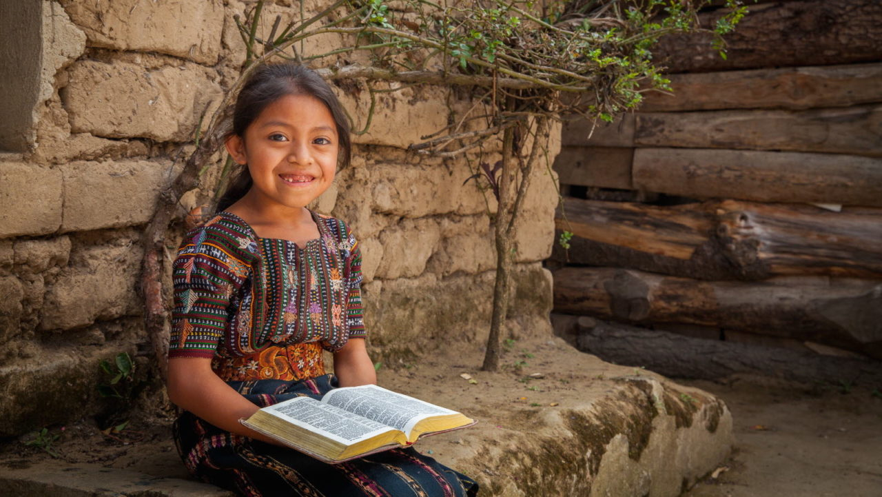Yennifer, age 6, holds her family's bible. She lives in Guatemala. ©2015 World Vision, Lindsey Minerva.
