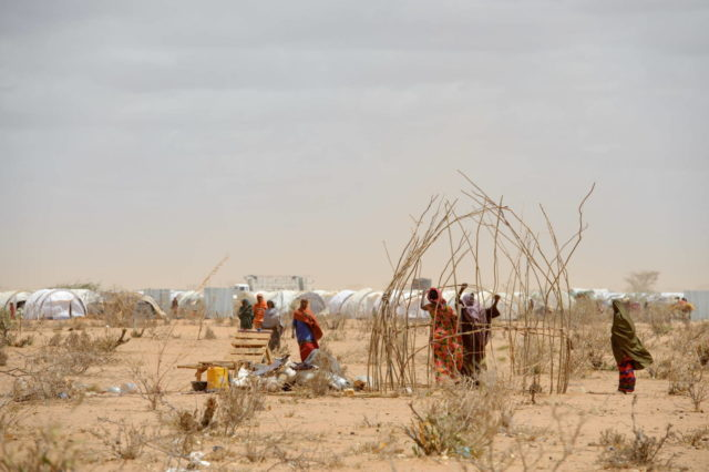 In this August 2011 photo, refugees fleeing drought in the horn of Africa set up a shelter after arriving at Dadaab camp in eastern Kenya. Home to more than 300,000 people, it's considered the largest refugee camp in the world. Earlier this year, the Kenyan government announced plans to close the camp and repatriate its residents to their native countries. (©2011 World Vision, Jon Warren)