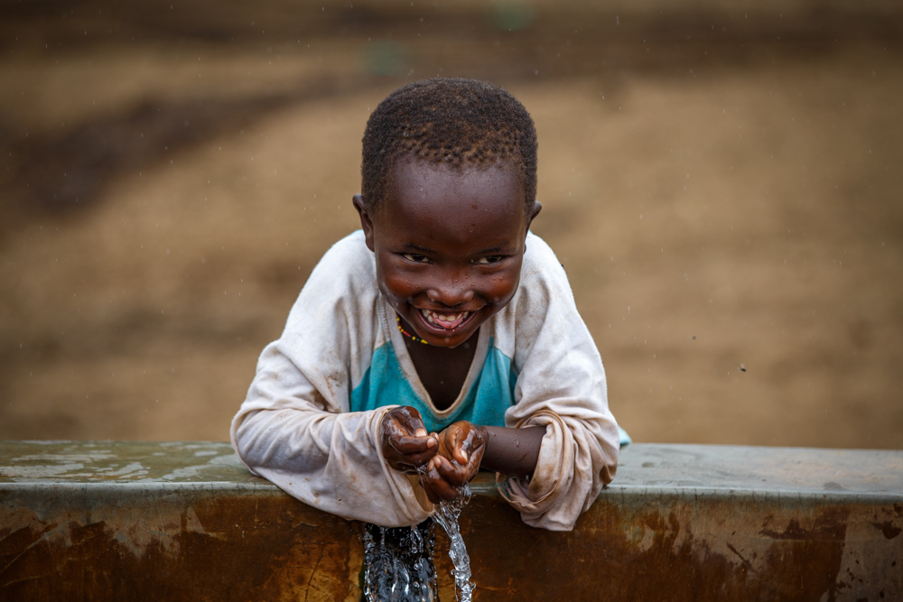 Naomi's son, Lamayan, 5, drinks clean water straight from the tap.