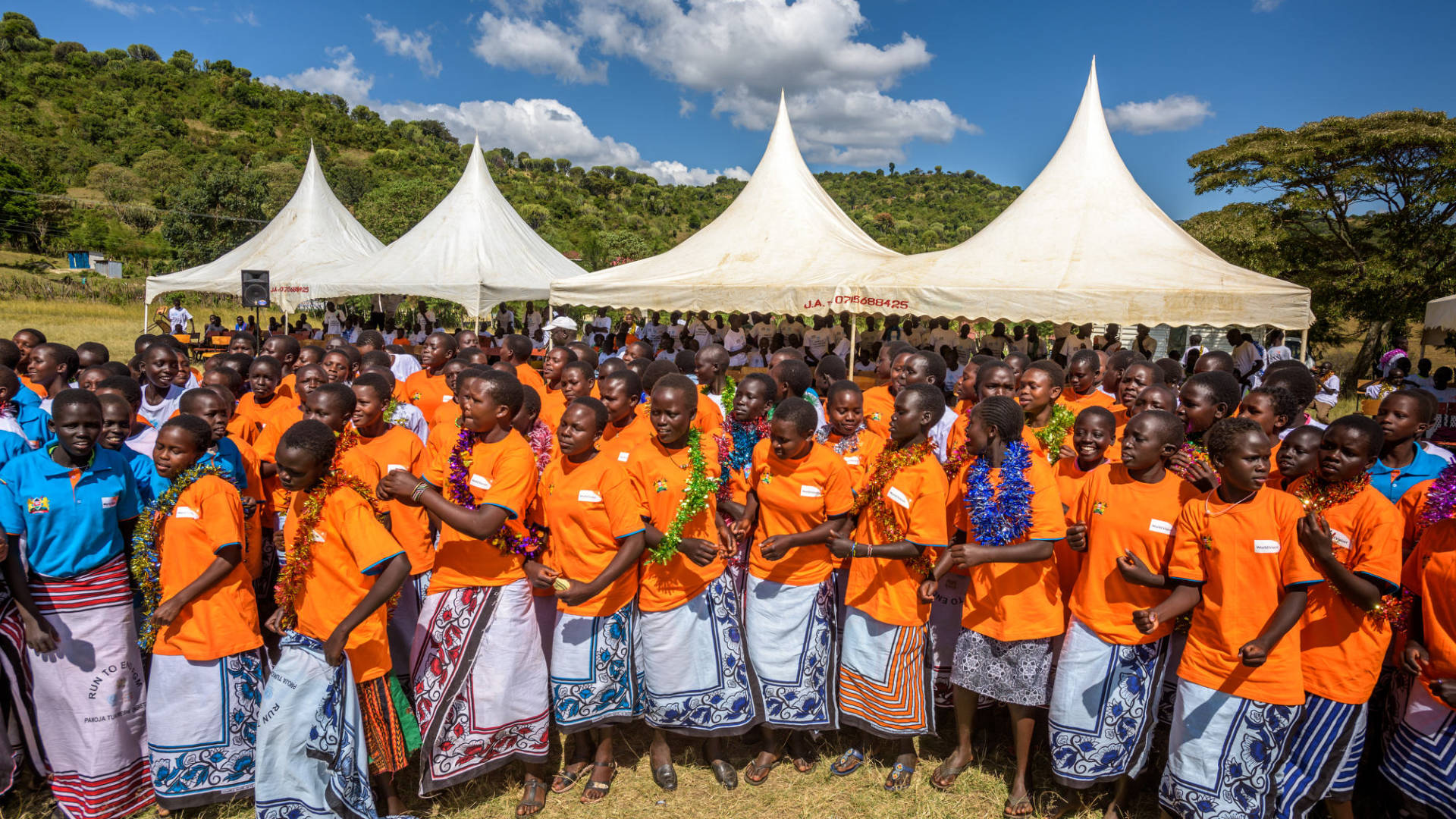 Teens celebrate graduation from a World Vision alternative rite of passage in West Pokot County, Kenya. Five hundred boys and girls took part in training to prevent female genital mutilation (FGM).