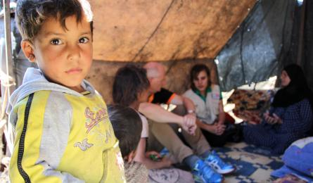 "A young Syrian refugee waits in a Lebanese refugee camp. Click to play video: ""Starvation is a war crime."""