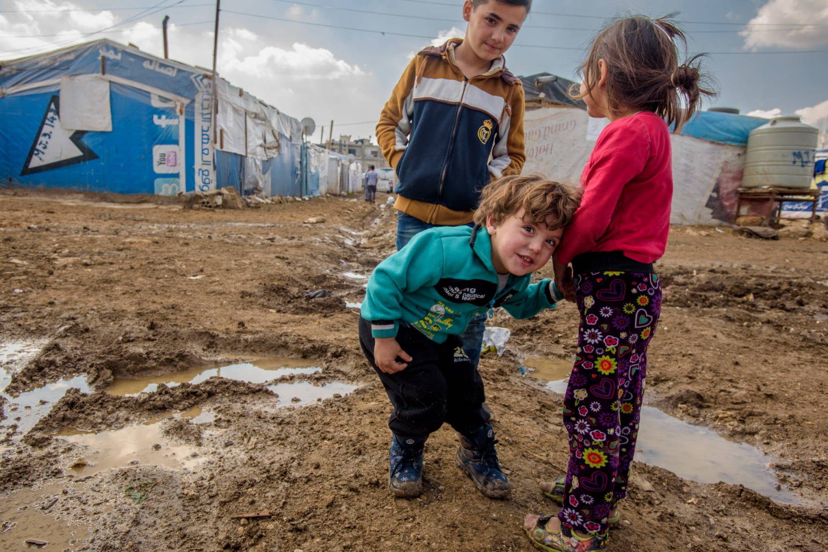 Help Syrian refugees like shy and fearful Mohamed, 2, who seldom ventures from his family's tent without holding tightly to his cousin Malak's hand. Both his parents died in Syria.