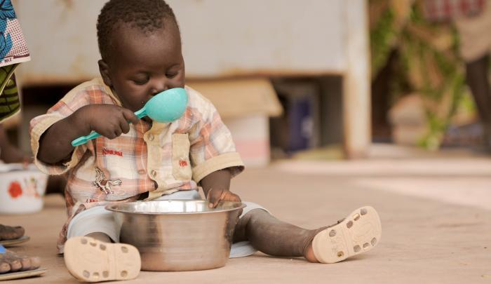 Malian child eats nutritious porridge