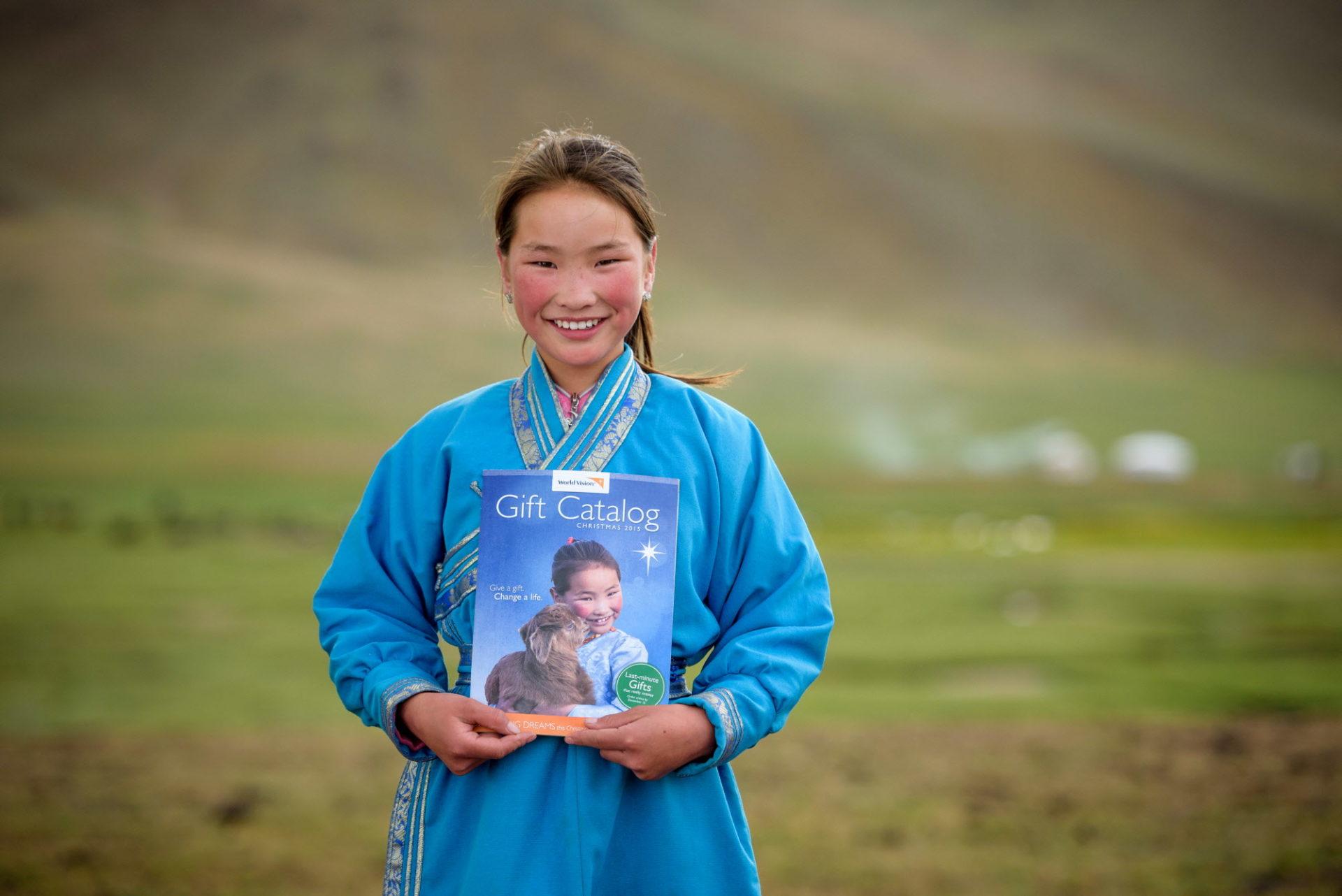 Mongolian girl holding catalog